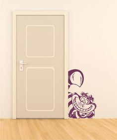 Cheshire cat peeking out from next to the closet. Cute for the Alice themed room.