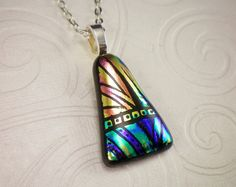This beautiful pendant features pinks, purples, yellows, blues, and greens. Its all in a hand etched, high contrast fun design thats perfect for everyday wear. Each piece is handmade by me and is one of a kind. All pieces are annealed for a lifetime of enjoyment.  MEASUREMENTS: >>This pendant measures 1 1/4 inch by 3/4 inch. (glass only)<<  Comes with 18 inch silver tone chain. The large bail opening also makes it easy to add your own favorite chain.