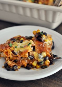 Tex-Mex Enchilada Casserole: Cheesy enchilada goodness wrapped up in casserole form with black beans, sweet corn, and a delicious made-from-scratch sauce. My favorite Mexican-style dish!