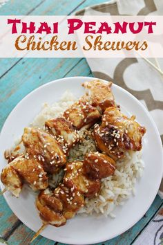 Thai Peanut Chicken Skewers paired with rice are a quick prep, fun and yummy lunch or dinner idea for busy schedules from This Mama Loves.