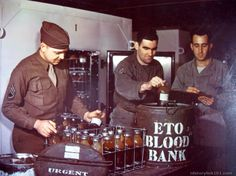 Supply Sgt.'s check and record whole blood being shipped to field hospitals somewhere in France. The containers also contain dry ice to keep...