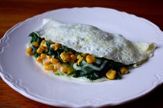Try this spinach and corn omelet filled with smoked gouda cheese for breakfast! It has 19 grams of protein! #healthy #recipe