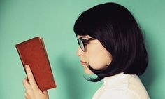 Profile of a young woman reading a book