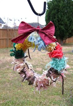 A yarn wreath. It's for birds to use for nesting materials.    I Can't Keep Up with a Blog ...: Oh, it's..... lovely?