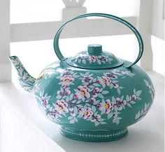 I collect tea pots for display on my patio artfully placed between flowing flowers. I collect tea pots for display on my patio artfully placed between flowing flowers.