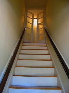 basement stairs looking down. love the french doors at top of stairs  Cuts down on heat Door At The Top Of Stairs Design Pictures Remodel Decor and