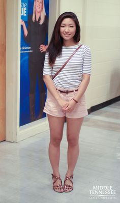 MTSU student Eunji Park wears a nautical white and blue stripe top over khaki shorts and a thin brown belt and studded brown sandals