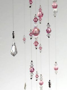 Made only with Swarovski Crystal this chandelier mobile is a statement piece. With 312 Swarovski Crystal beads of varying shapes and sizes in light pink and clear crystal, this is bling! This gorgeous mobile will add glam to a wedding or look amazing in a nursery. A memorable