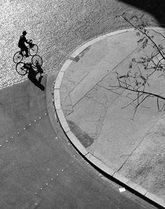 André Kertész :: Paris (man on bicycle), 1948   more [+] by André Kertész