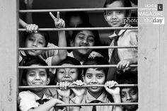 """Let's take a look at our Photo of the Day Award winner for May 18, """"Out of Syllabus, by Nirupam Roy."""" Photographer Nirupam took this documentary photograph in Tufanganj, Coochbehar, West Bengal. The photograph portrays the life of school going kids and their limitless joy during the limited amount of time they get to breathe the fresh air of happiness. Do you feel nostalgic seeing these kids cherish their good times at school?"""