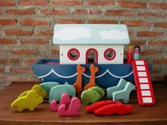 Wooden toys, Noahs Ark boat play set includes 1 men, 1 women, 1 ladder, some animals that are pair as well as orange giraffes, red crocodiles, blue elephants, yellow lions, green sheeps, pink monkeys, and blue dogs. Made of wood. Habitat wooden toys (UK). ♥ The roof of the boat can be get into and get off ♥ So cute. :) ♥ Perfect for Habitat (UK) toys lovers. (No Box) ♥ The Noahs Ark boat and animals are finished with nontoxic. ♥ A perfect for boys and girls. ♥ Used and good condition…