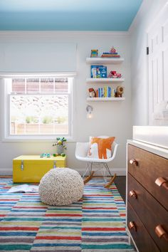 Contemporary Kids' Room: Window-lit nursery with kids toys and fun furniture..