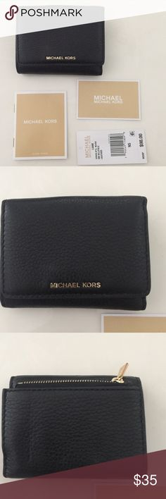 """NWT Michael Kors Liane Pebbled Leather Wallet New with tags Michael Kors """"Liane"""" black Lambskin peppbled leather wallet. Trifold with buttoned closure. Approximate measurements: 4.5"""" W and 3.5"""" H. Comes with care booklet as pictured. ⚓No trades or holds. I negotiate only through the offer button. Any measurements listed may vary slightly however I do my best in using a soft tape measure and measure all items carefully. 🚭🐩 T2 MICHAEL Michael Kors Bags Wallets"""