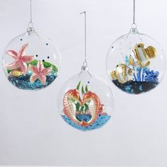 """$69.99-$84.99 Pack of 6 Beach Party Nautical Tropical Glass Ball Christmas Ornaments 4.25"""" - From the Beach Party Collection Item #T0505  Add an exotic nautical theme to your Christmas tree this holiday season Ornaments feature pairs of glass starfish, seahorses, or fish with seashell and seaweed accents Each ornament is filled with blue glitter to create a traditional snow globe effect Fully di ..."""