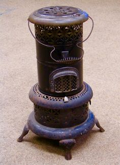 During the early 70s power cuts were fairly common in the UK. Without power the central heating system in our house couldn't function, so we had paraffin heaters. The ones we had looked almost exactly like this. To the day I die, I will never forget the strong noxious odour they produced.