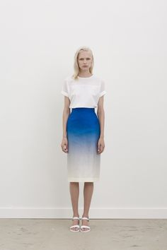 #GARYBIGENI TOP: RUSSELL - Front yoke laser cut shirt. Available in black & white / Fabric: Italian Cotton. SKIRT: AGEM - High waisted skirt with back vent. Exclusive gradient print in collaboration with Eduardo Santos. Available in blue/marshmallow only / Fabric: Silk Dupion. For more information on stockists & availability, please visit: garybigeni.com