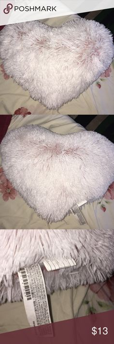 Heart shaped furry pillow Got this from forever 21 a year ago and didn't really get to use it. It's been sitting in my closet. 100% clean. From a smoke free and pet free home. And it's white and heart shaped. Forever 21 Accessories