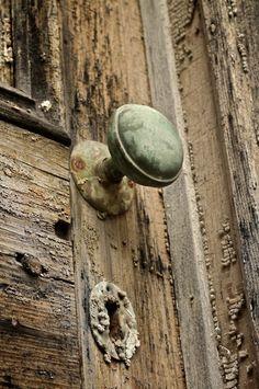 old door with door knob - weathered rustic patina