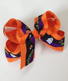This piece is so sweet, it's spooky! Easy to clip onto any 'do, this frilly-fun bow lets glamour ghouls show off their Halloween spirit and style sense at the same time.
