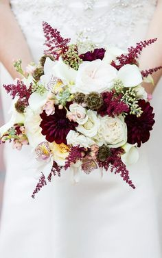 This bouquet is filled with all different types of flowers (roses, peonies, and orchids) and, therefore, lots of texture. The deep marsala dahlias are stunning, and the rich color brings to mind a...