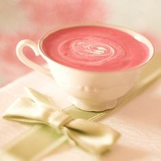 A Pretty Cup of White And Pink  Strawberry Hot Chocolate.