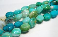 Natural Peruvian Blue Opal Oval Gemstone Beads.  Peruvian opal (also called blue opal) is a semi-opaque to opaque blue-green stone found in Peru which is often cut to include the matrix in the more opaque stones.  Blue opal also comes from Oregon in the Owhyee region as well as from Nevada around Virgin Valley.