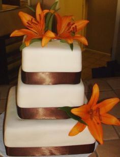 lilies -     Google Image Result for http://www.wedding-planning-101.com/image-files/autumn_wedding_cakes.jpg