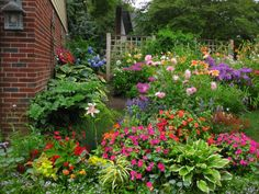 """Garden """"rooms"""" (perennial, shade, memorial,...) can be viewed from inside the house - magardenside.jpg"""