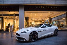 The beautiful Aston Martin Vanquish Carbon, seen here in stunning Stratus White on location for a recent invitation-only event at the Opera Gallery in Dubai. Discover Vanquish Carbon Edition: http://astonmartin.com/vanquish-carbon
