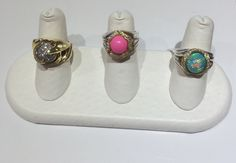 Pictured here are 3 ORBIS rings, 1 gold and 2 two-toned, all three with diamonds. The ring on the far left showcases a diamond bullet, the ring in the center has a bubblegum pink sphere, and on the far right we have the mint green opal sphere being displayed. If you have any questions or would like to know any details such as prices you can contact the store via the info on our website, or email: sayerspinterest@gmail.com
