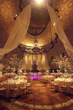 ooh i like the fabric hanging from ceilings then down and out. Also gold linens :)