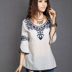 I love embroidered tunics and blouses!  In general, I would prefer a dark color (navy, olive, purple, rust).