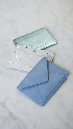 Cool off your commute with our Leather Travel Card Holder, in an ice blue metallic leather and with two card holders.