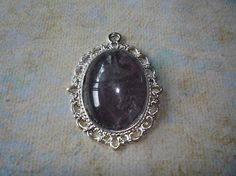 Dark Crystal Pendant 1 1/2 by 1 Chain included.