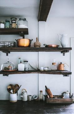 dark wood shelves in kitchen for dishware and cooking tool storage / sfgirlbybay