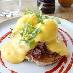 A house specialty, the Ox Cheek Benedict showcases two perfectly runny eggs piled onto waffles and a generous stack of slow cooked ox cheek, all topped with hollandaise and sriracha. http://www.foodiehub.tv/fast-feasts/europe/London/review/Duck-Waffle/Ox-Cheek-Benedict/8235_8466