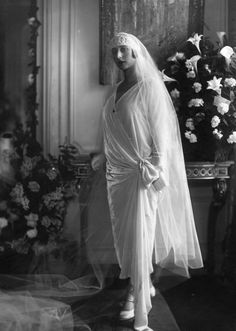 1925 Mademoiselle Loewenstein modeling a white wedding dress fastened on one hip and accessorized with a very long veil. 1925 Mademoiselle Loewenstein modeling a white wedding dress fastened on one hip and accessorized with a very long veil. Wedding Dress Trends, White Wedding Dresses, Wedding Attire, Wedding Bride, Wedding Tips, Wedding Shot, Wedding Ceremony, 1920s Wedding, Bride Dresses