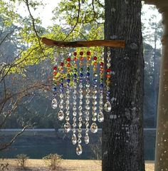 9 Strand Rainbow and Waterfall Suncatcher Driftwood Crafts, Wire Crafts, Cristal Art, Diy Wind Chimes, Beaded Curtains, Garden Crafts, Beads And Wire, Wire Art, Mobiles