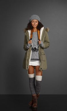Mid length jacket + grey hat + grey leg warmers + grey sweater + short boots + swap skirt for tights