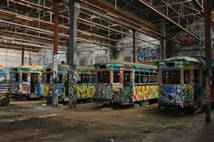 Tucked away on a patch of wasteland in Glebe, New South Wales, the remains of six historic Sydney trams sit side by side in the abandoned Rozelle Tram Depot.  Scrawled with graffiti and gutted from the inside, the trams date back to the 1930s when they were part of a network of streetcars operating across Sydney.