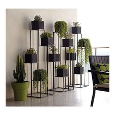 Quadrant Plant Stand with Four Planters (C)... sadly to buy these 3 stands and 12 planters at the store would set one back about 800$.