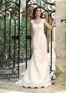 Avon    This lace with tulle slip gown in the colour ivory-champagne is simple yet striking! We love the figure-hugging silhouette in combination with the lace cap sleeves.    Available in Ivory or White.