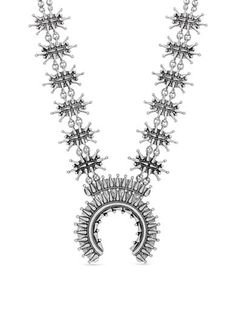Designed with semi-precious rock crystal and tribal-inspired accents, this statement necklace is sure to turn heads. Pair this silver-tone style with any outfit for a great look!