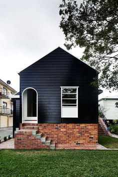 Image result for Black or dark gray houses with modern pop of color accents