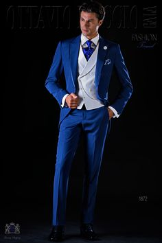 Italian bespoke electric blue frock coat wool mix suit with peak lapels, satin contrast and 1 button. Wedding suit 1872 Fashion Formal Collection Ottavio Nuccio Gala.