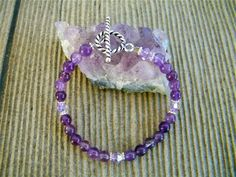 Amethyst, the Calming Gemstone Handmade Bracelet | Stones in Harmony, accented with matching Swarovski bicone crystals. Handcrafted with love. ©Elizabeth Wald.