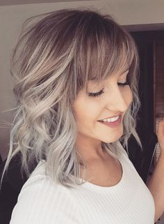 Hottest silver blonde balayage hair color ideas for medium length hairstyles flattering on women with thick or thin hair