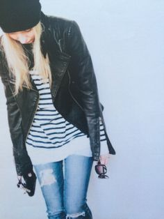 Leather jacket, striped top and ripped jeans.