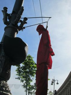 "Kiev fascists are hanging ""dolls"" wearing communist party cap, shirt and pants as a warning."