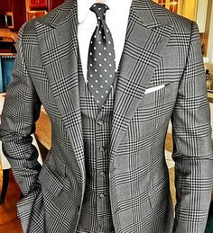 A classic grey Prince of Wales suit by Signori Armadio, blending a traditional pattern with a modern cut.
